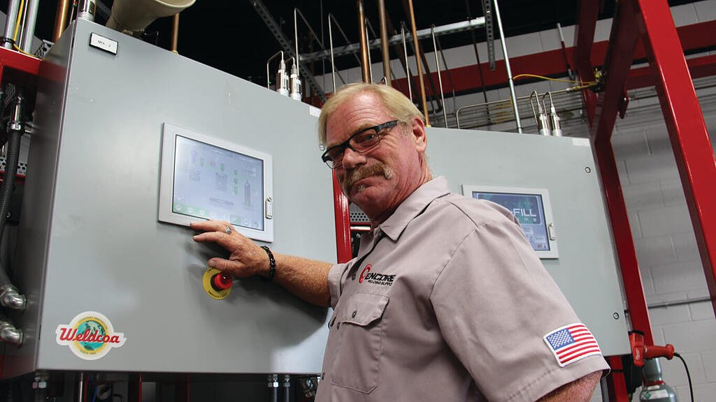 Encore Welding and Industrial Supply employee at a Weldcoa branded control panel