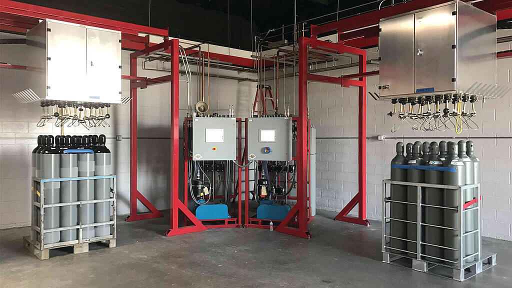 Weldcoa installed gas cylinder fill station with various gas cylinders in racks