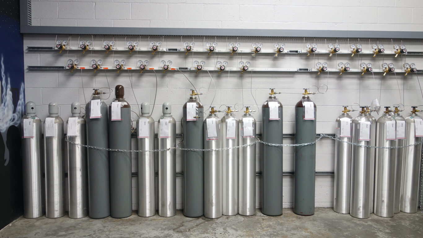 various gas cylinders getting filled with a Welcoa automated fill system