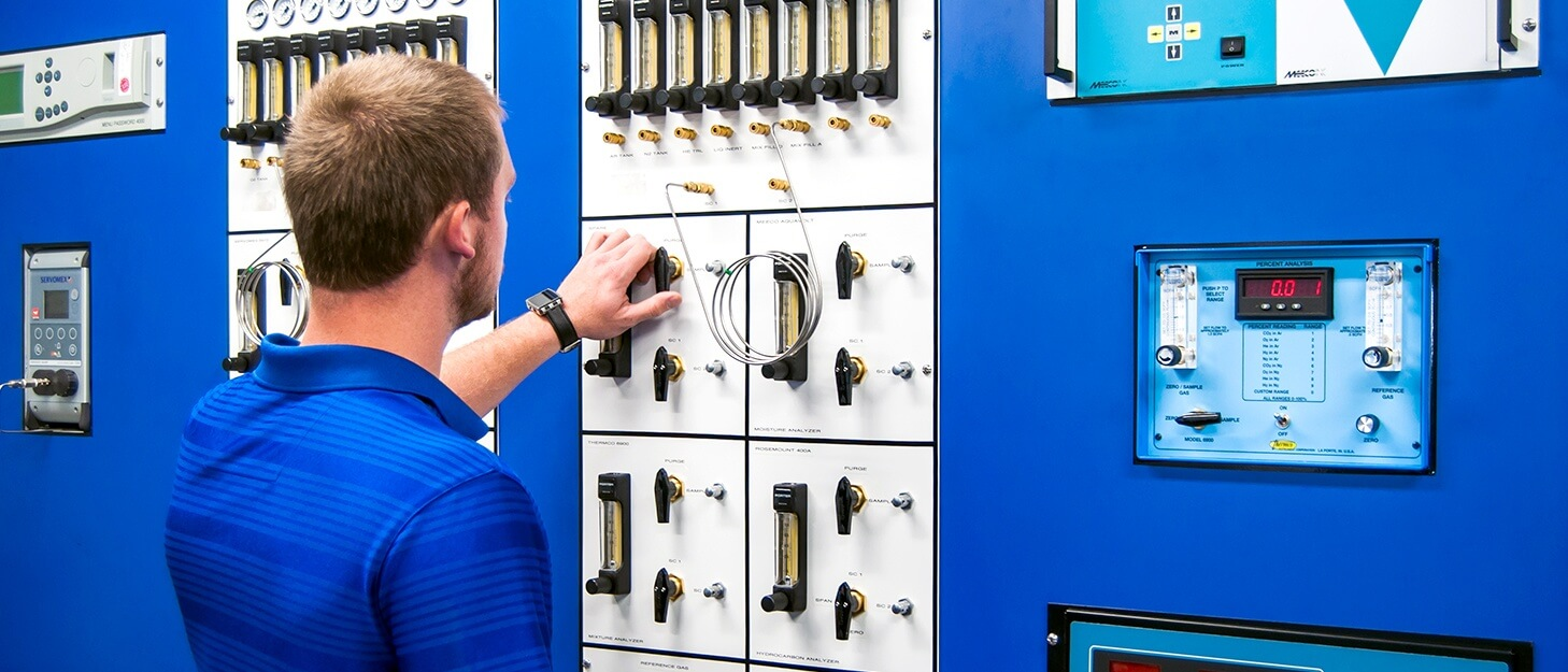 man working at a control panel