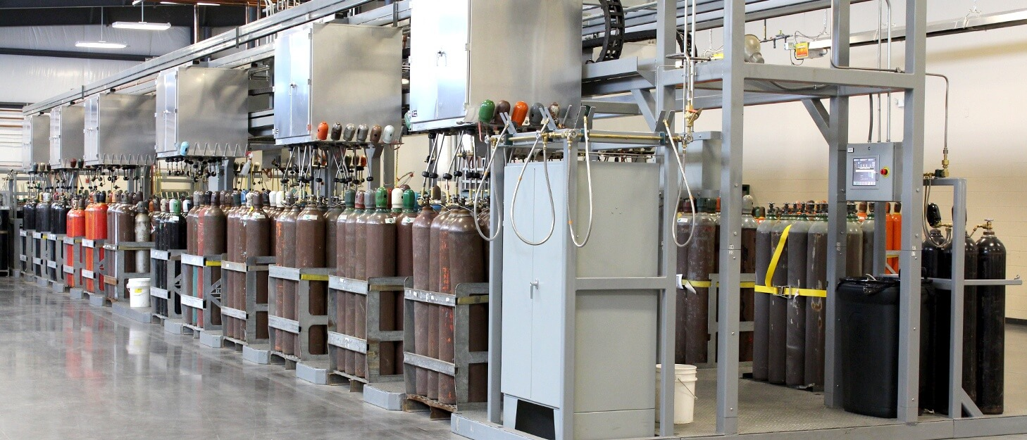 various gas cylinders getting filled by a Weldcoa automated filling station
