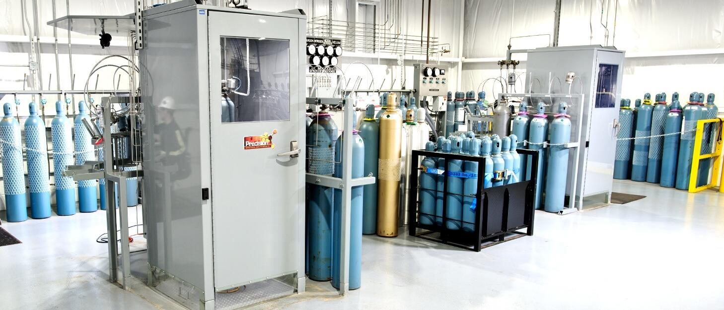 automated gas cylinder filling station with various gas cylinders in racks and on pallets
