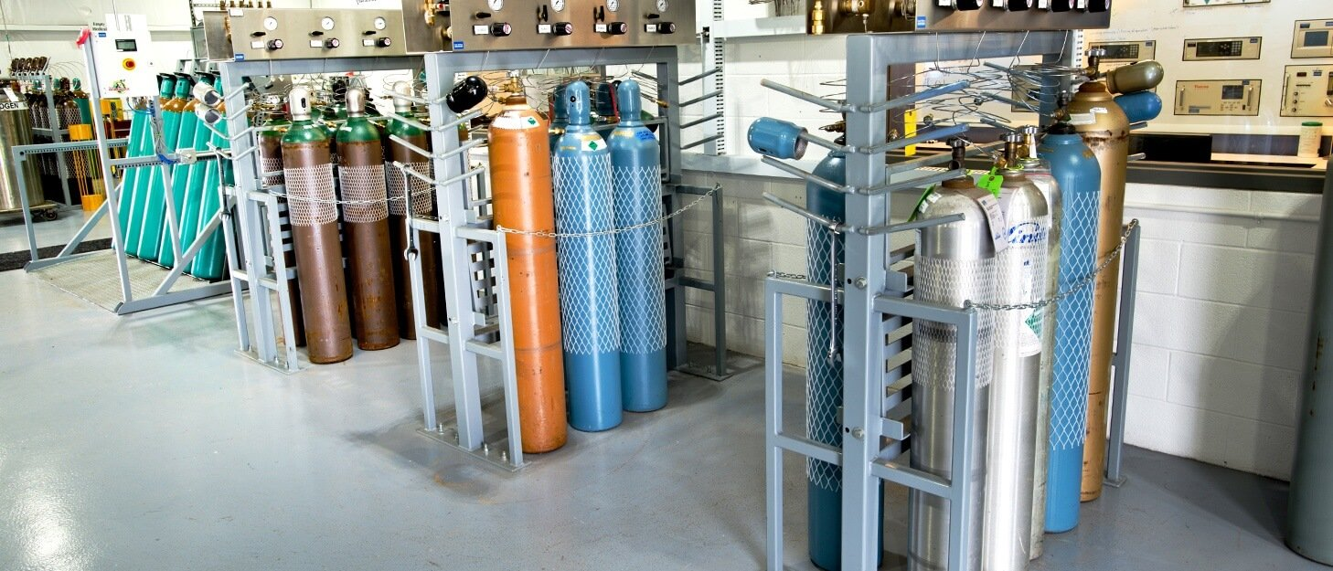 gas cylinders in racks being filled