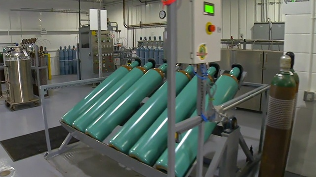 gas cylinders in a holding rack