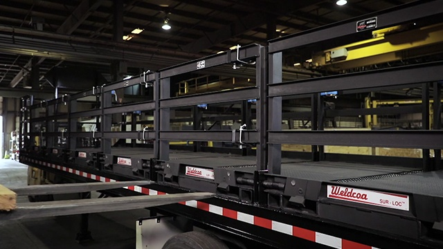 forklift removal of a Weldcoa Sur Loc pallet from a truck bed