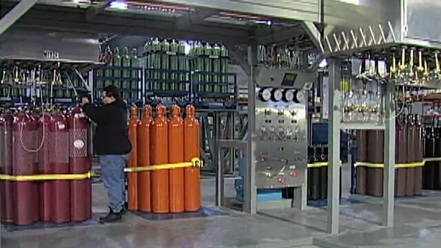 Weldcoa automated fill station with a variety of gas cylinders