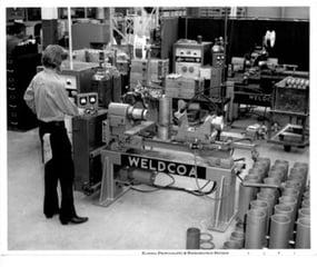 Man machining Weldcoa gas cylinders